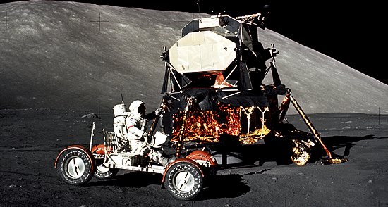 Apollo 17 mission commander Eugene Cernan drives the lunar roving vehicle during the early part of the first moonwalk at the Taurus-Littrow landing site. The Lunar Module is in the background. Apollo 17 began on Dec. 7, 1972, with the first night launch in the history of America's human spaceflight program. A Saturn V rocket carrying Cernan, Schmitt, and Evans lifted off from the Kennedy Space Center lighting up the Florida skies en route to the moon. Four days later, Cernan and Schmitt touched down in the moon's Taurus-Littrow highlands. Image Credit: NASA/Harrison Schmitt