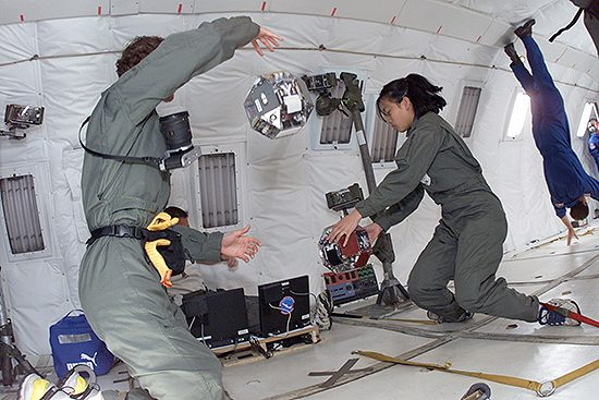 Students_test_SPHERES_on_NASA_KC-135_reduced_gravity_aircraft_(JSC2000-E-09952)