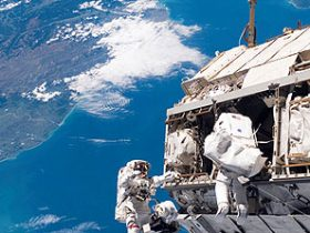http://www.nasa.gov/multimedia/imagegallery/image_feature_719.html Backdropped by a Colorful Earth STS-116 Mission Specialists Robert L. Curbeam, Jr. (left) and Christer Fuglesang participate in the first of the mission's three planned sessions of extravehicular activity as construction resumes on the International Space Station. Image credit: NASA